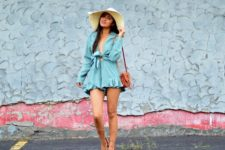 With beige wide brim hat, brown bag and lace up sandals