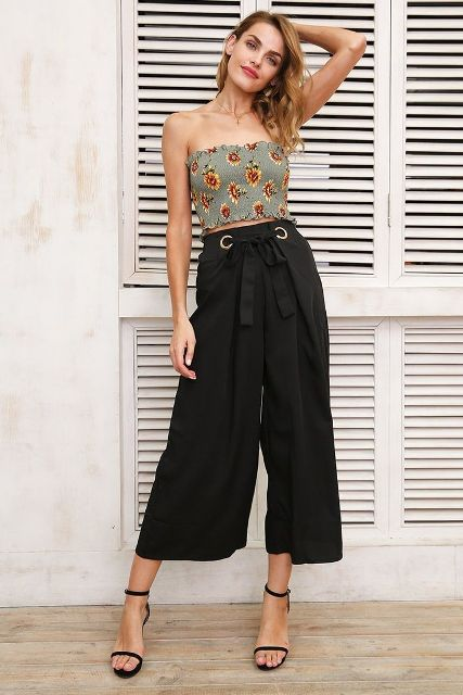 With black belted culottes and black ankle strap high heels