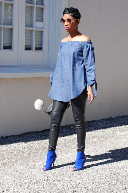 With black leather pants, clutch and blue cutout ankle boots