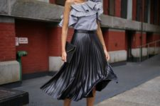 With black leather pleated midi skirt, black clutch and black ankle strap high heels