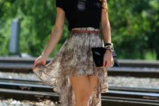With black t-shirt, black clutch, brown belt and three colored shoes
