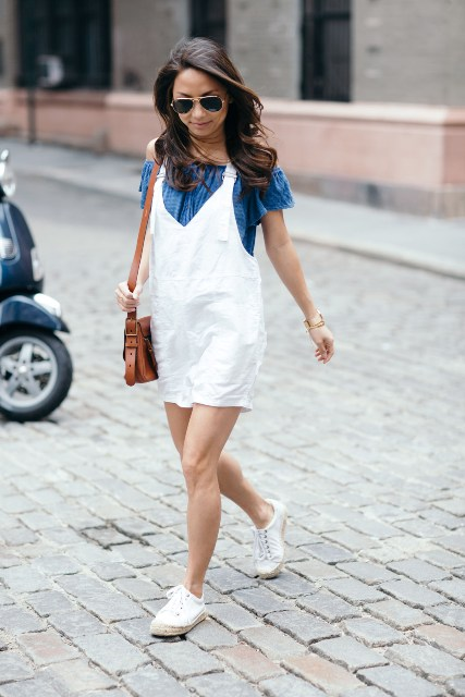 With blue off the shoulder top, brown bag and white flat shoes