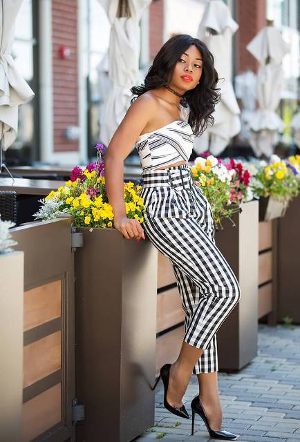 With checked belted trousers and black pumps