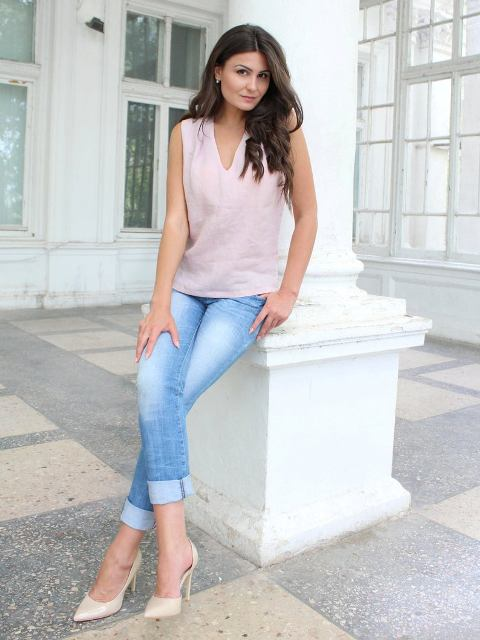 With cuffed jeans and beige pumps