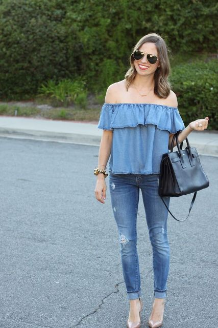 With cuffed jeans, black bag and beige pumps