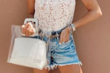 With denim shorts and transparent bag