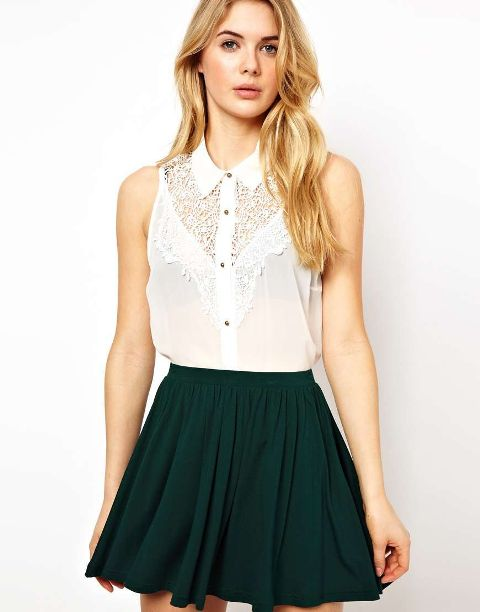 With emerald mini skirt