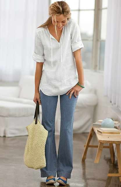 With flare jeans, blue flat shoes and tote bag