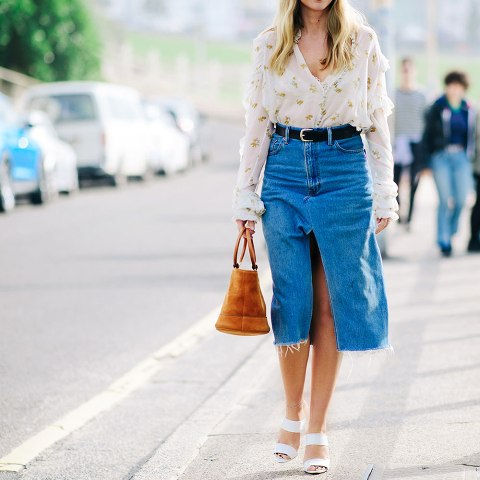 With floral blouse, brown suede bag and white sandals