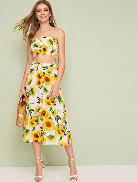With floral high-waisted midi skirt, straw bag and white high heels