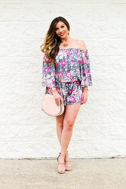 With floral off the shoulder romper and beige shoes