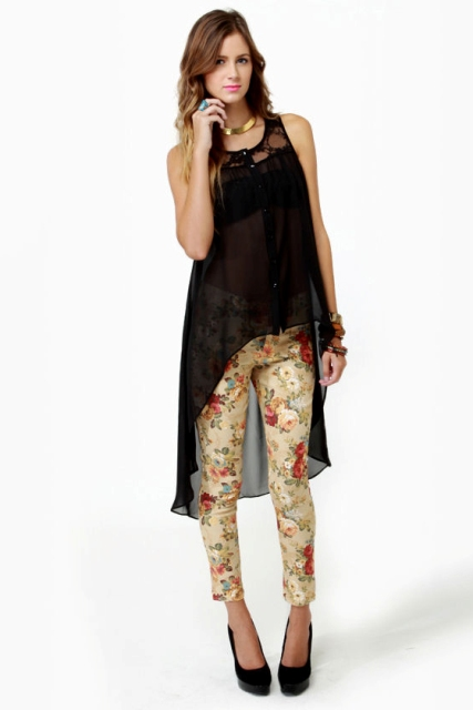 With floral trousers and black platform shoes