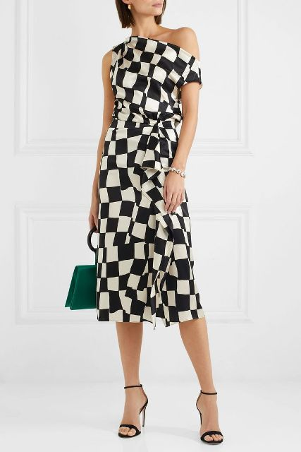 With green leather bag and black ankle strap high heels