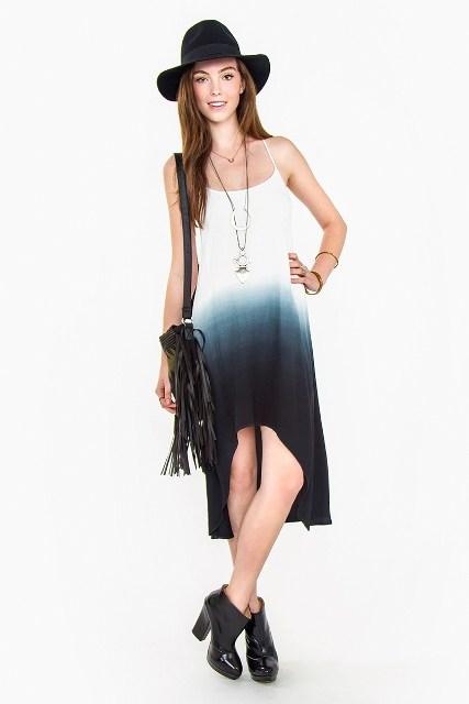 With hat, fringe bag and heeled boots