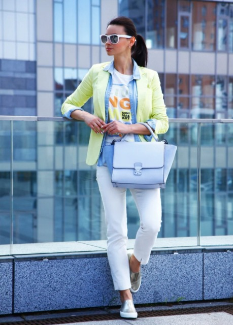 With labeled t shirt, denim shirt, light yellow blazer, white pants and silver flat shoes