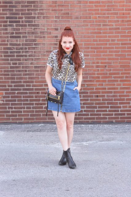 With leopard printed shirt, chain strap bag and black boots