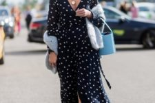 With light blue bag and white low heeled shoes