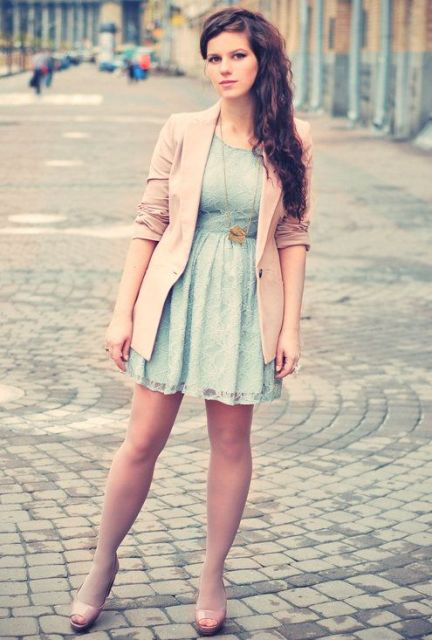 With light blue mini dress and beige sandals