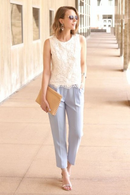 With light blue trousers, beige clutch and heeled shoes