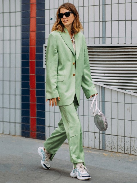 With mint green pants, rounded bag and sneakers