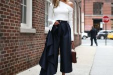 With navy blue culottes, brown bag and white flat mules