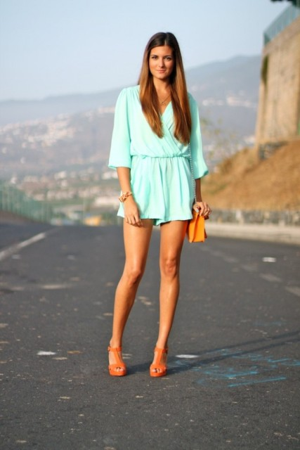 With orange chain strap bag and orange sandals