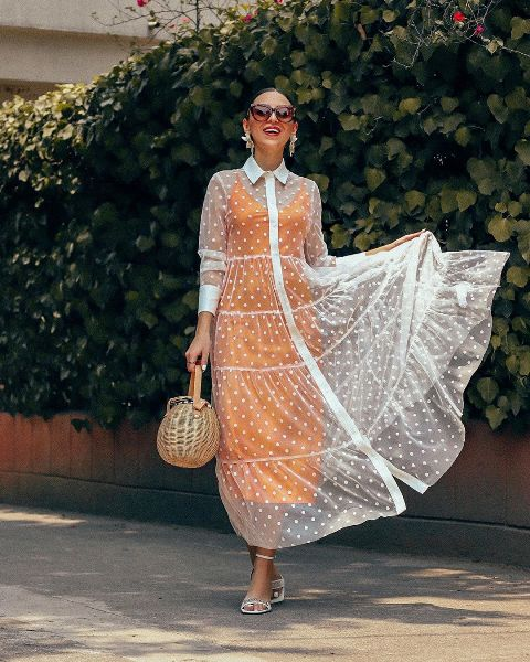 With orange midi dress, straw bag and white sandals