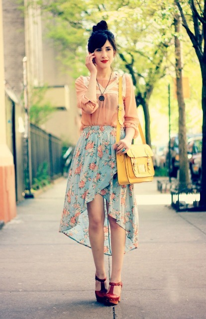 With pale pink blouse, yellow bag and red platform sandals