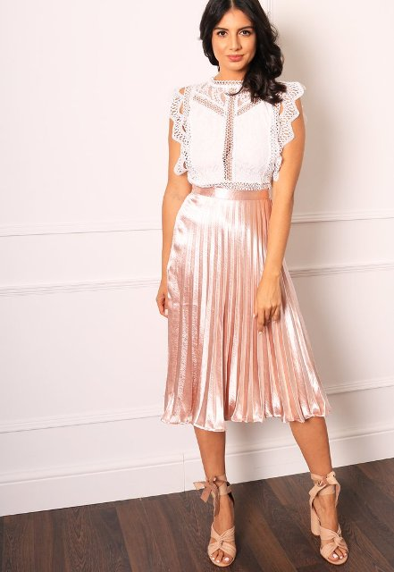 With pale pink pleated midi skirt and lace up shoes