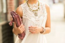 With pale pink trousers, necklace and suede clutch