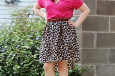 With pink t-shirt and brown flat shoes