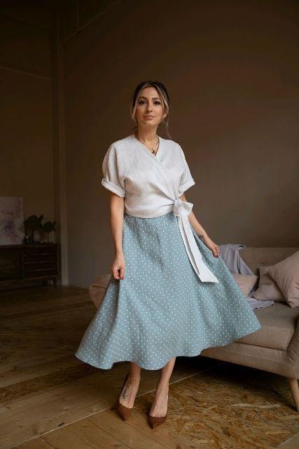 With polka dot midi skirt and brown pumps