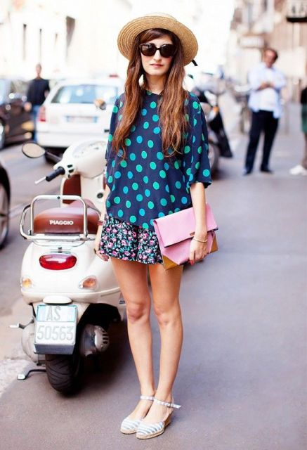 With polka dot shirt, wide brim hat, floral shorts and striped shoes