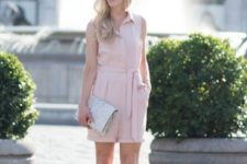 With printed clutch and low heeled shoes