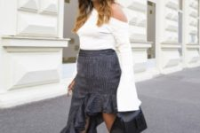 With printed ruffled skirt, black bag and black mules