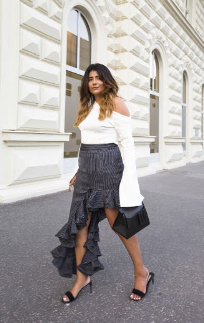With printed ruffled skirt, black bag and black mules