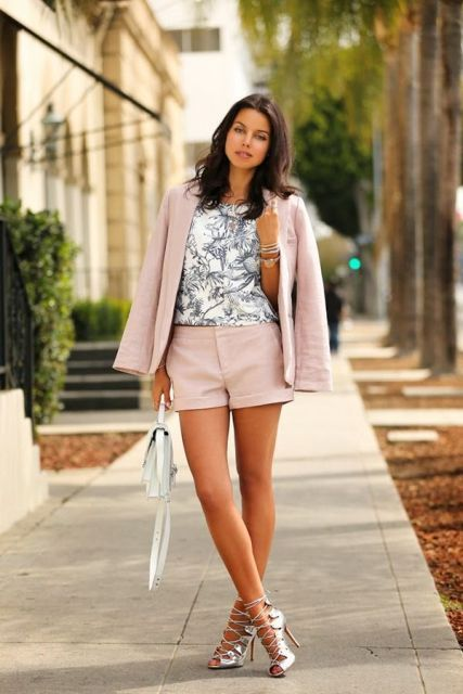 With printed t shirt, pale pink shorts, white bag and lace up high heels