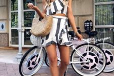 With ruffled wrap skirt, straw bag and white embellished sandals
