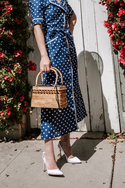 With straw bag and white pumps