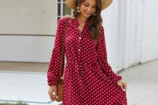 With straw hat and brown rounded bag