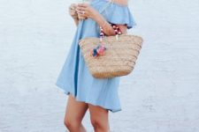 With straw tote bag and brown low heeled sandals