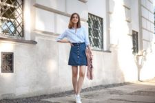 With striped button down shirt, fringe bag and white sneakers