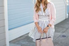 With striped dress, pale pink cardigan and black flats
