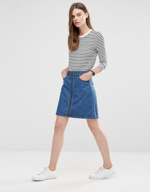 With striped shirt and white flat shoes