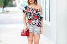 With striped shorts, red chain strap bag and high heels