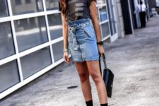With t-shirt, chain strap bag and black sock boots