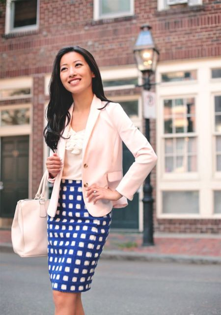 With top, beige bag and white and blue checked skirt