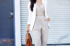 With white blazer, brown leather bag and high heels