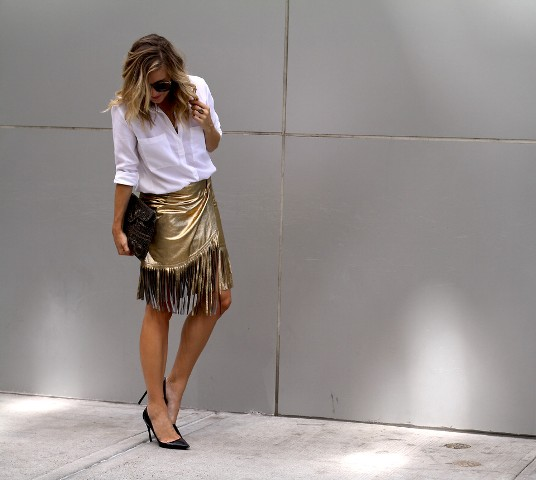 With white button down shirt, black clutch and black pumps