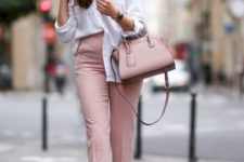 With white button down shirt, pale pink cropped pants and white shoes